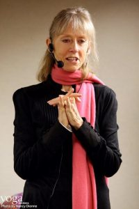 Sally Kempton speaking in a pink scarf